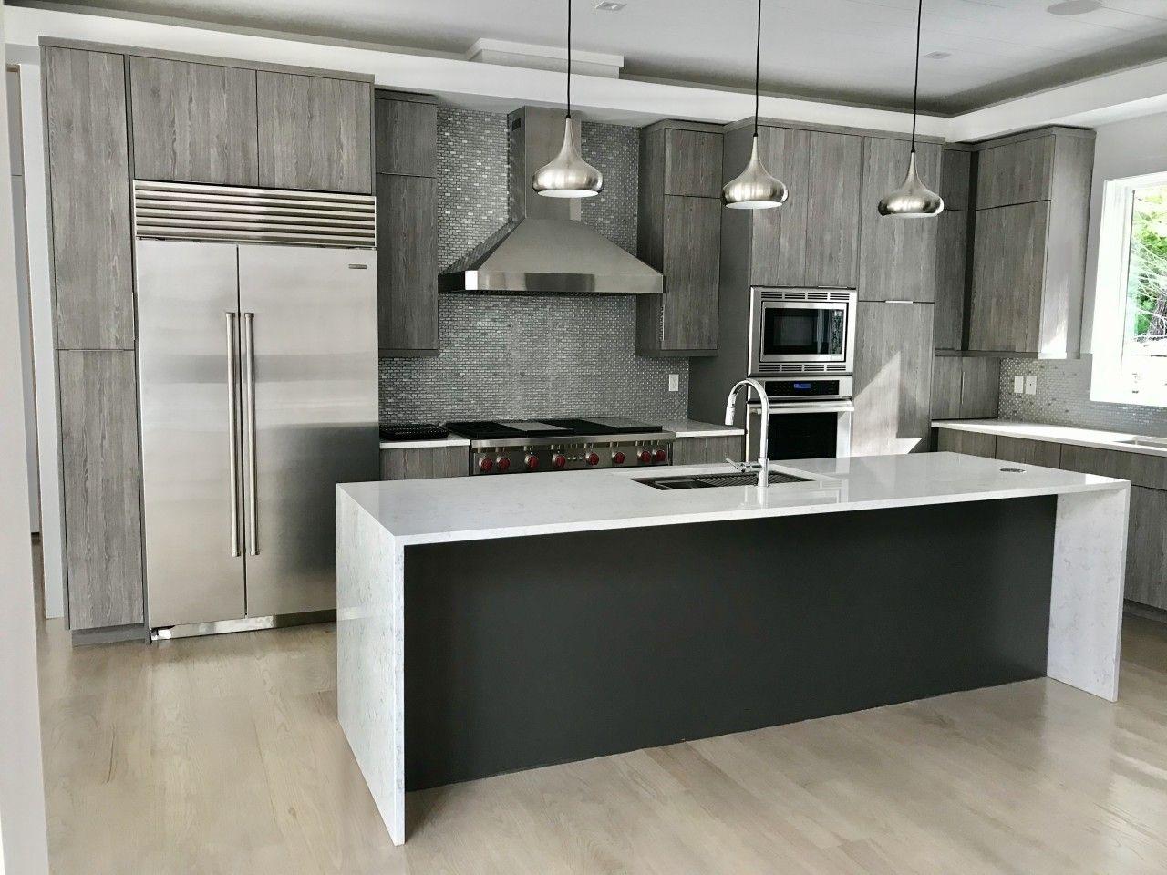We Love This Grey Textured Modern Kitchen With Complimentary Secondary Tones Greytextured Waterfallisland Contemporary Kitchen Modern Kitchen Kitchen