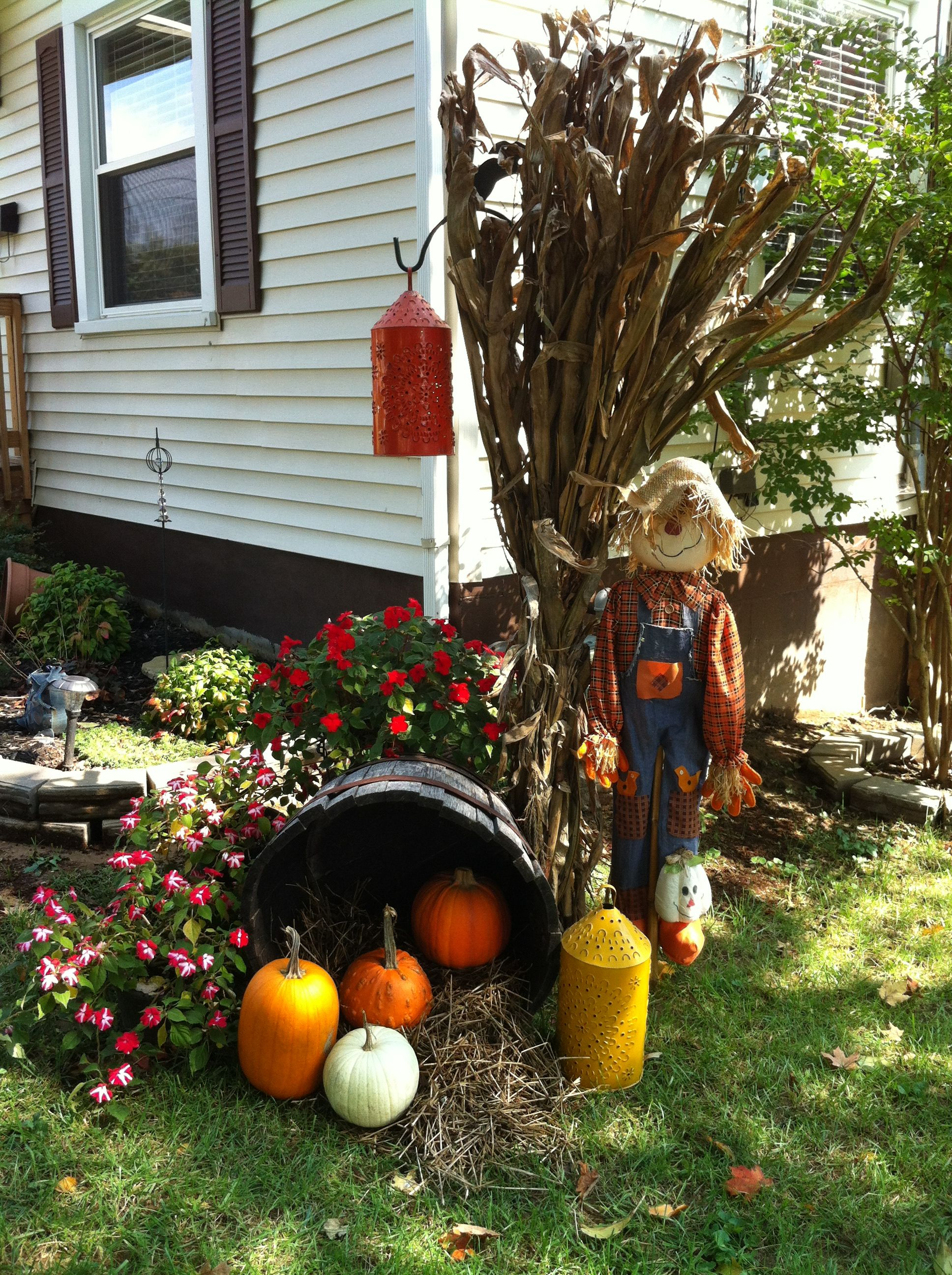 Outdoor fall decorating latern on shephards hook for Pinterest halloween outdoor decorations