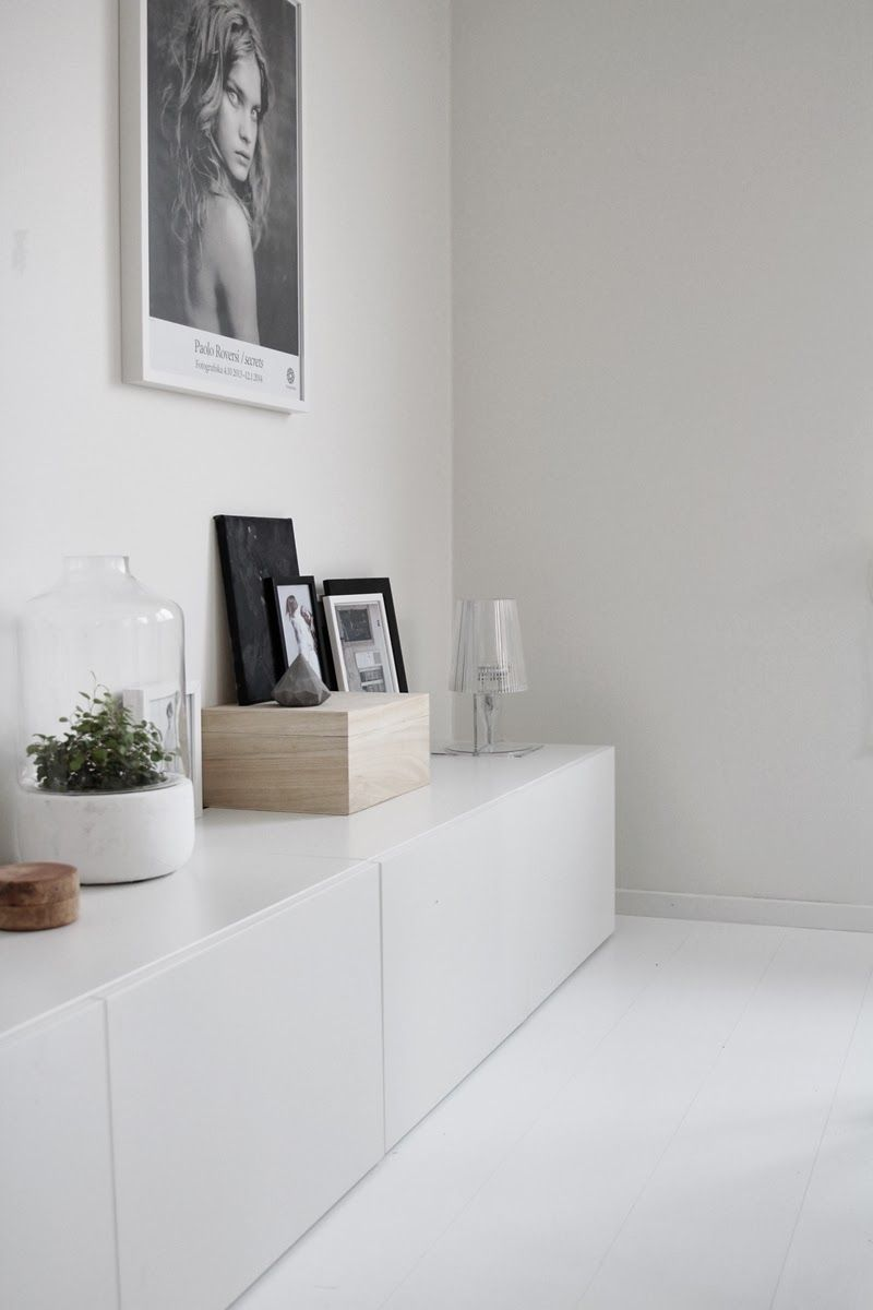 Love all white; white wooden floors + white walls + white sideboard; i would only add ...