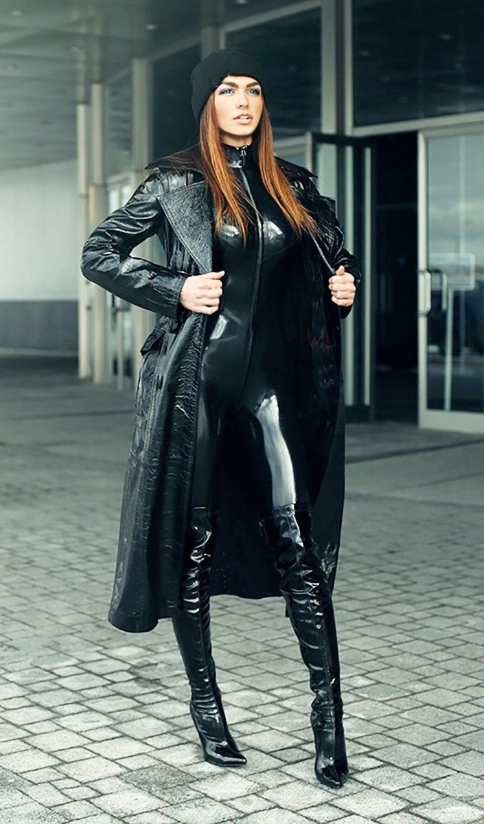 Holly Halston Latex throughout casual black latex catsuit and thigh boots under leather trench