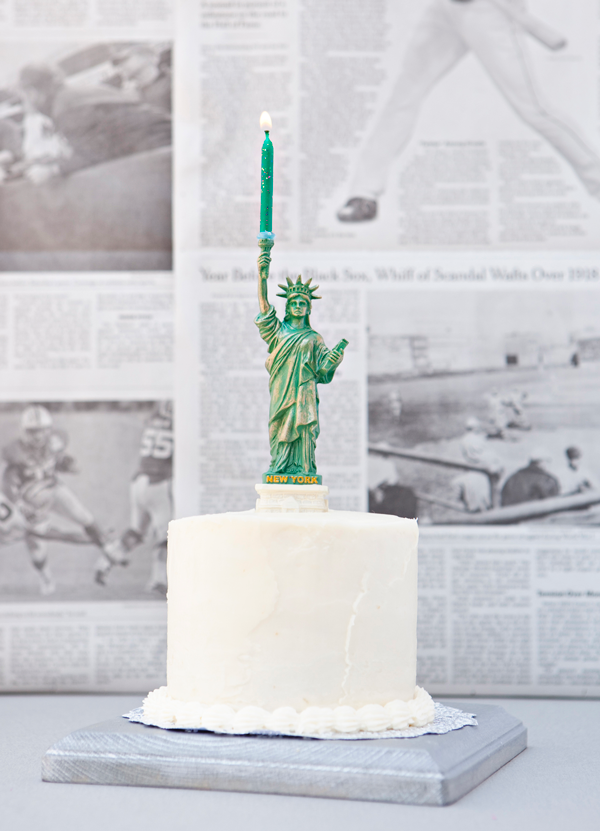 Lady Liberty Holding A Birthday Candle