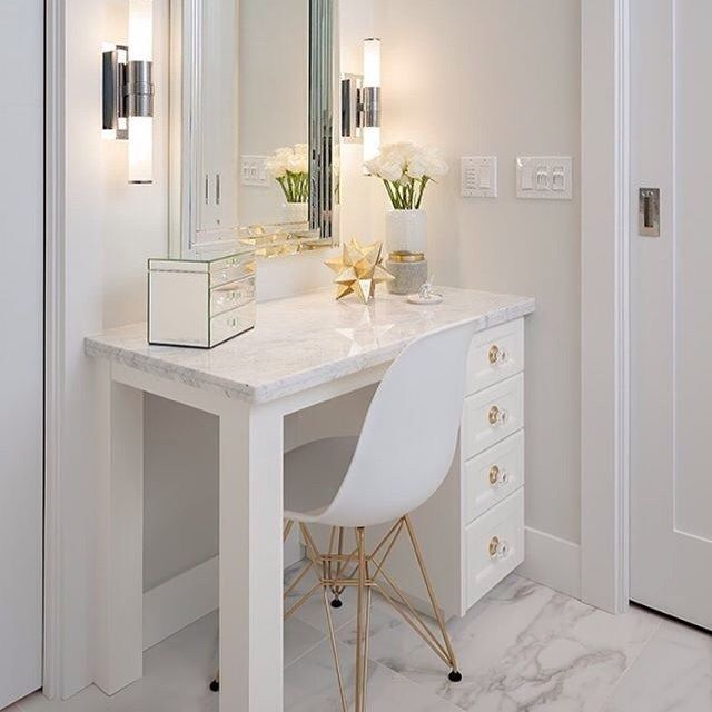 Sparkle and glamour in this morning-prep area  #whiteonwhite #glamor #glamour #glamorous #glamourous #eameschair #vanity #desk #mirror #makeup #marblefloor #whiteandgold #goldandwhite #hollywoodregency #interiordesign #masterbathroom #renovation #glam ( # @thespottedfrog via @latergramme )  #SpringGreenInteriorDesign #SpringGreenDesign #SpringGreenLoves