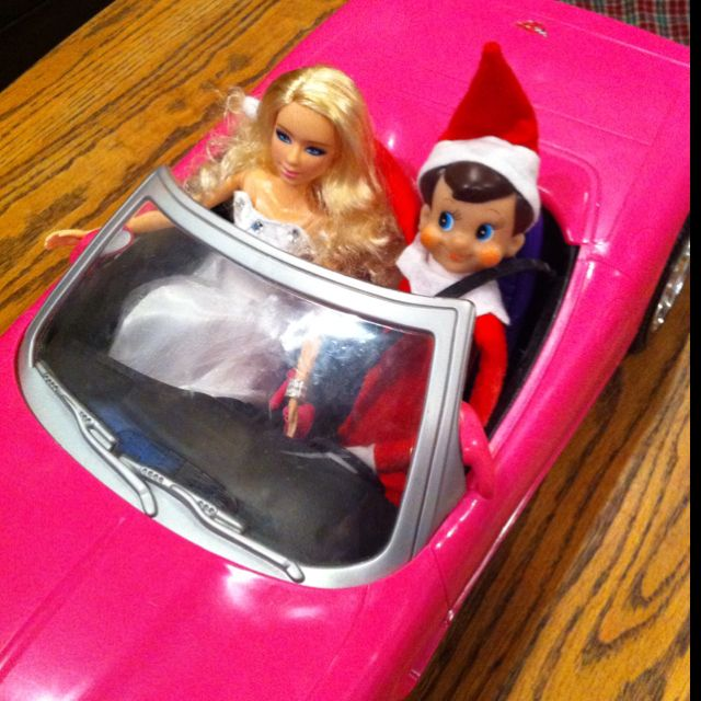 Elf on the shelf.  Watching a movie (drive in) with Taylor swift barbie
