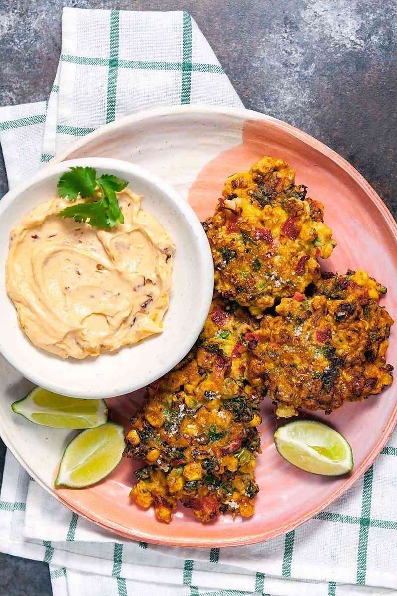 Turn up the heat with this Spicy Corn Fritters With Chipotle Dip recipe.