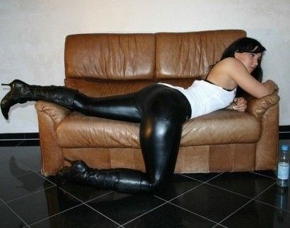 Shiny Leggings and Boots: Wet look leggings, stretched out on a loveseat.