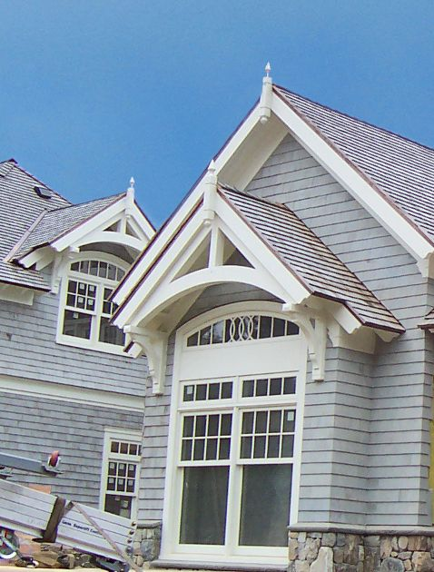 White exterior trusses adorning dormers on a cape cod ma for Cape cod dormers