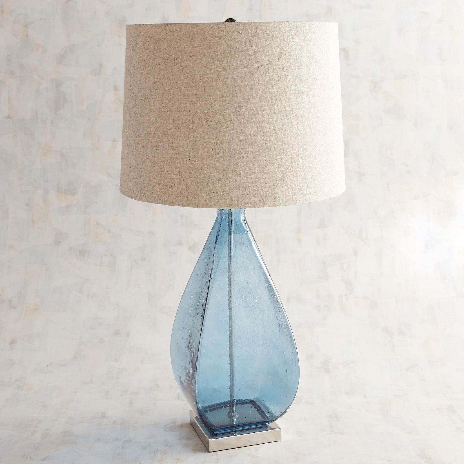 Turn On The Light And Our Doli Lamp S Blue Glass Reveals Tiny Bubbles Of Intriguing Texture Its Graceful Teardrop Shape Glass Table Lamp Blue Table Lamp Lamp