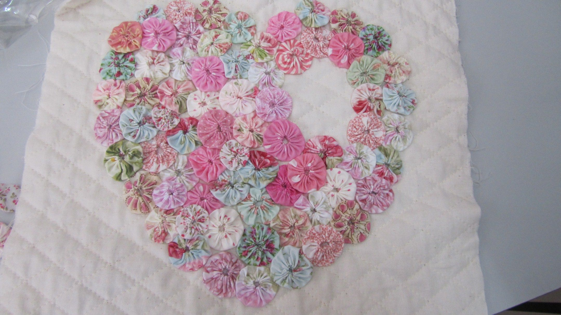 Sewing a shabby pink heart