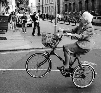 An old lady on a bike.