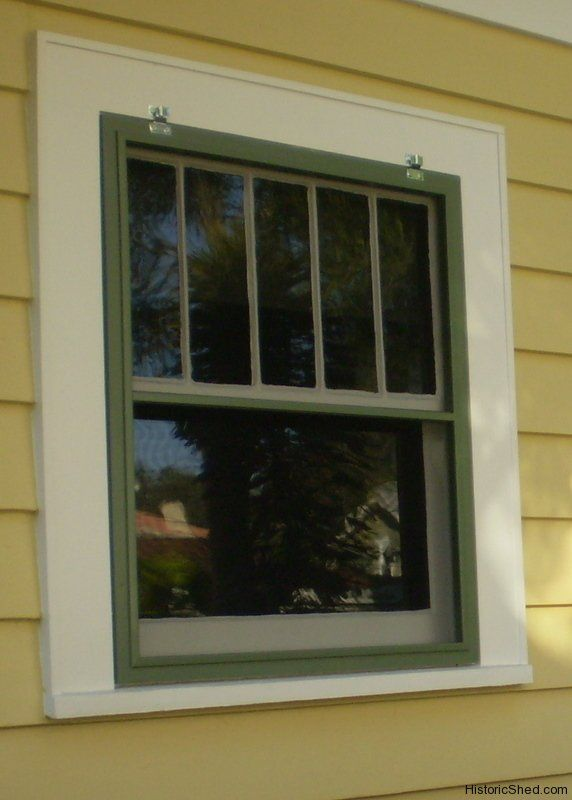 Wood window screen for a historic bungalow in st