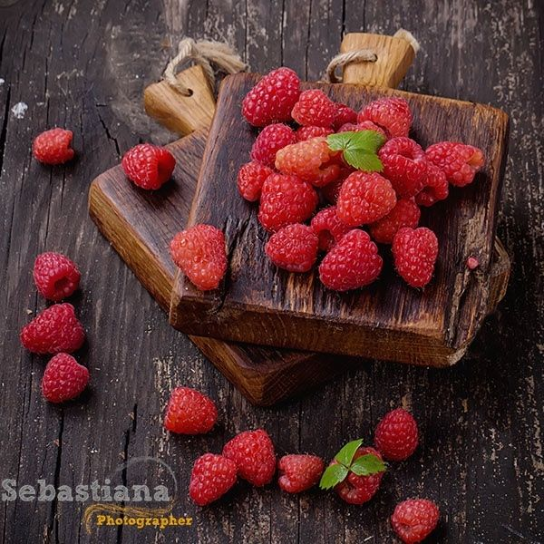 Raspberries on rustic wooden board - Fresh Organic Raspberries on vintage wooden boards over a rustic wooden background