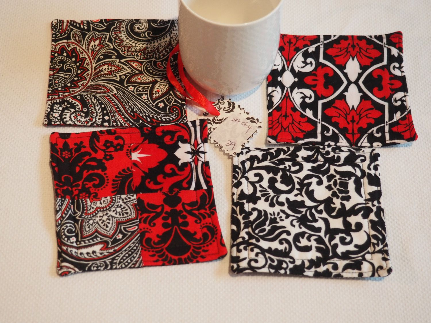 Red and black floral drink coasters, set of 4, handmade by AuntTerrysCreations on Etsy