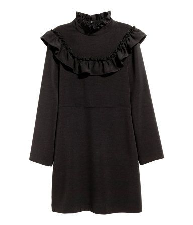 Black. Short dress in thick woven fabric with a ruffled collar and yoke. Opening…