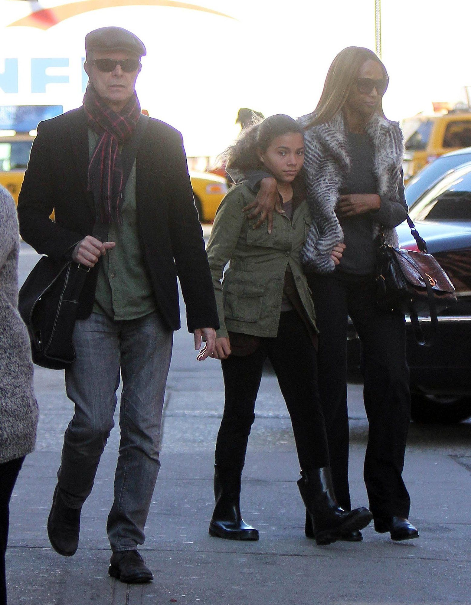 David Bowie And Wife Iman Traveling With Their Daughter Alexandria