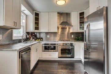 Stainless Backsplash And Appliances With White Cabinetry And Wood Stainless Steel Kitchen Backsplash Stainless Steel Tile Backsplash Trendy Kitchen Backsplash