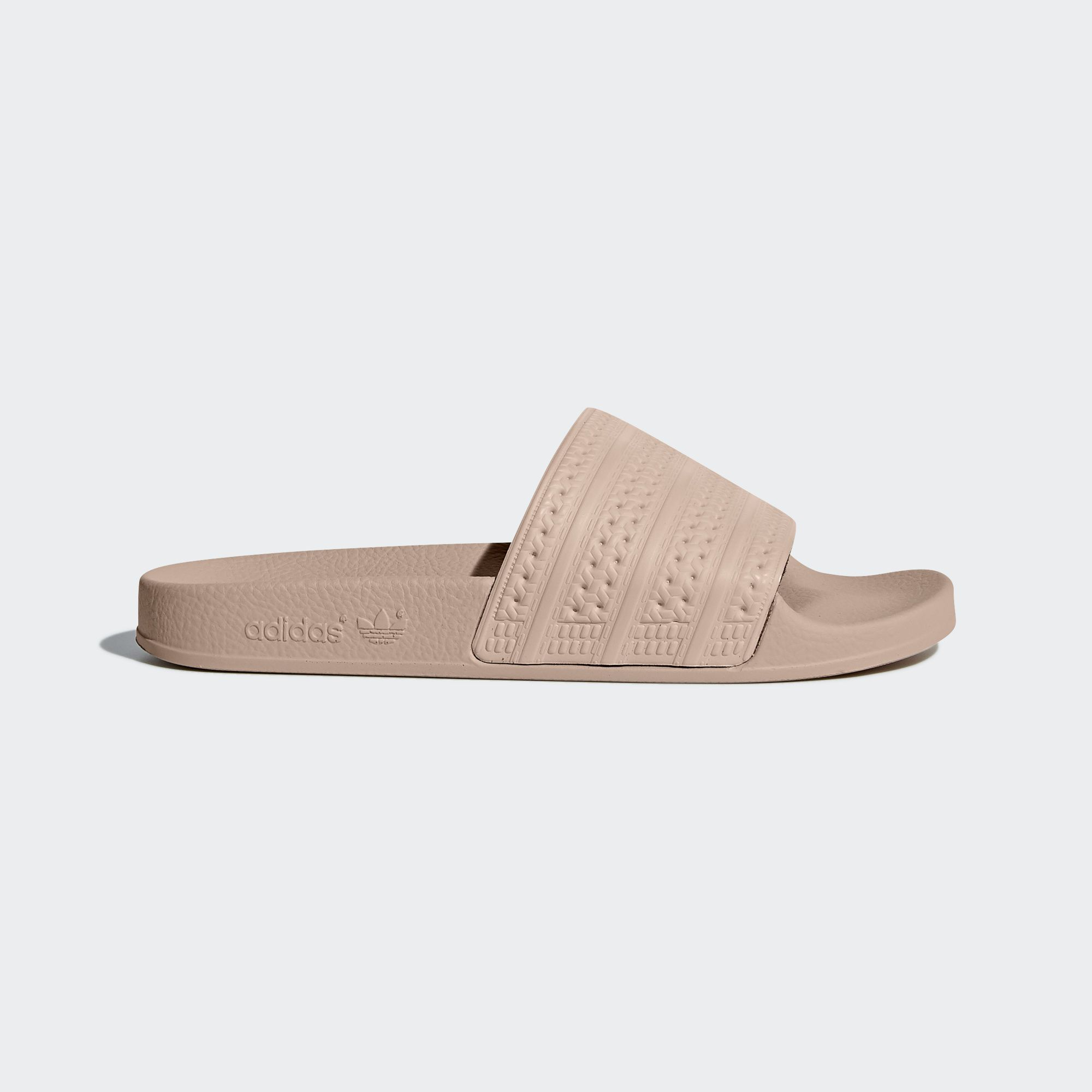 591a2da44e4b1a See all the styles and colours of Women s Adilette Slides - Pink at the  official adidas online shop Canada.