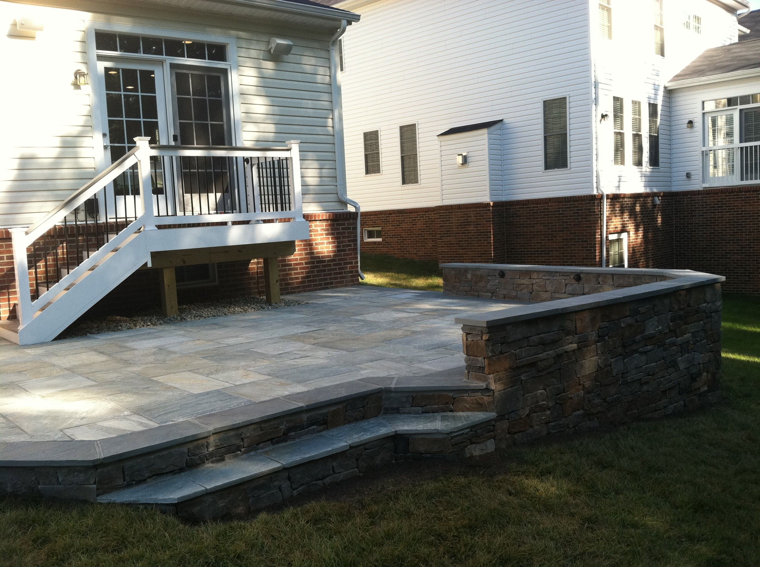 nice asian bluestone patio with ep henry durango sitting wall