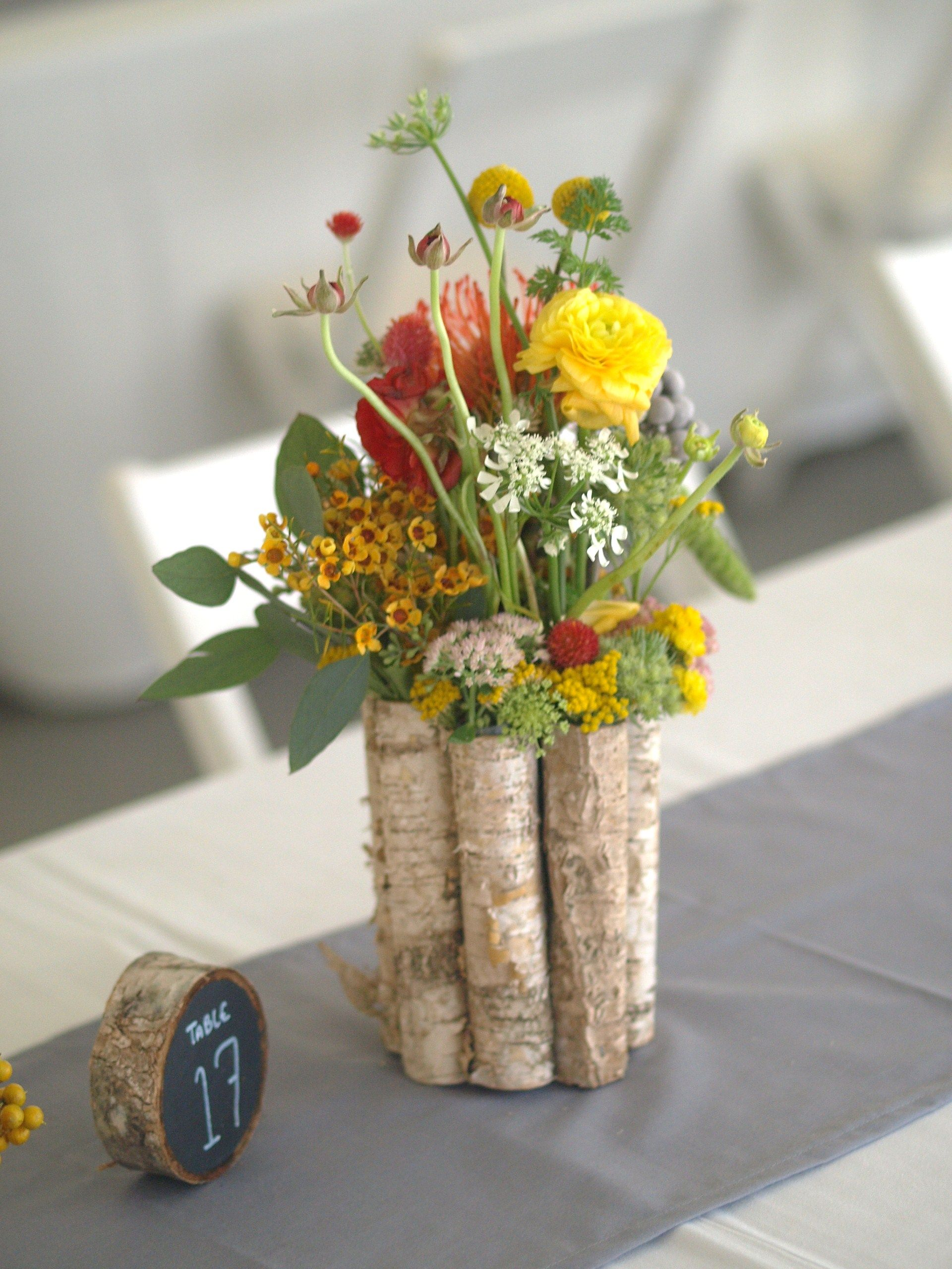 Orange and yellow wildflower centerpiece