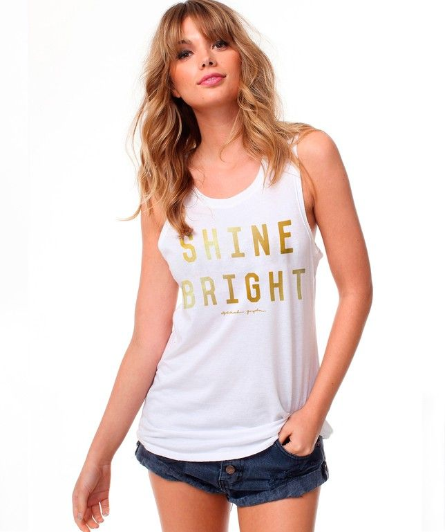 41742705f3909 Spiritual Gangster Shine Bright Muscle Tank comes in white with gold foil