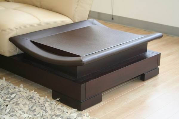 Dark leather coffee table in living room | Furniture design ...