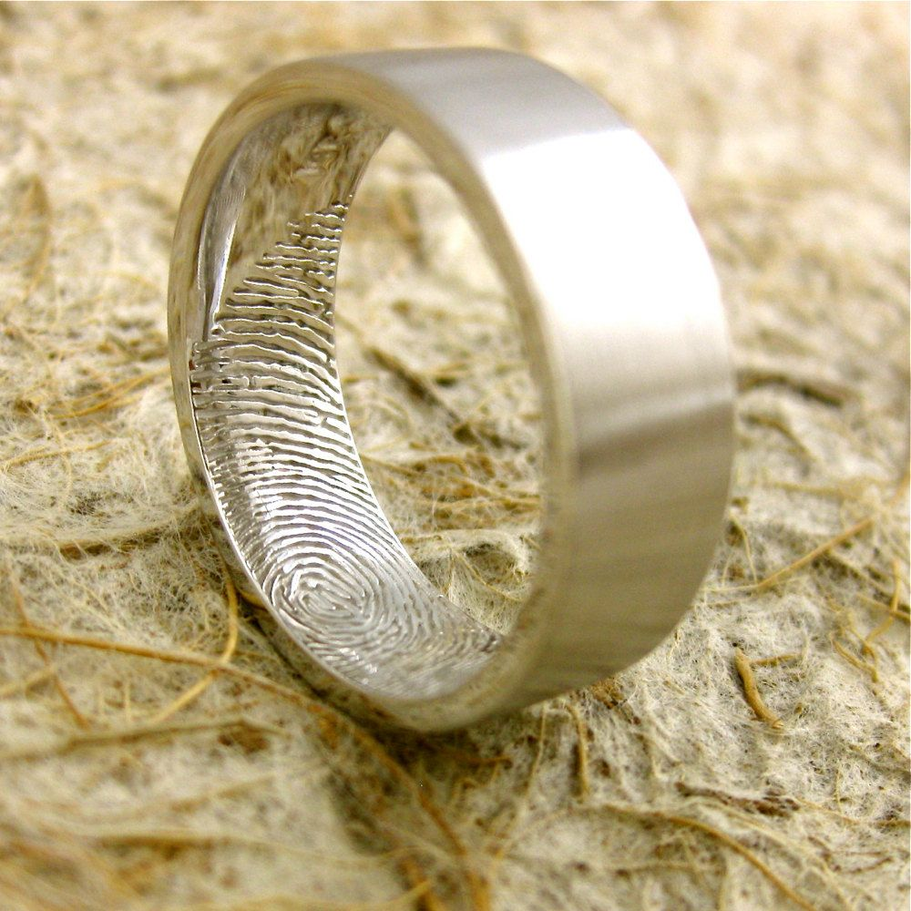 Brides fingerprint inside the grooms wedding band I really like
