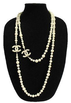 b0f8e4150d2c41 This iconic Chanel necklace is an elegant strand of faux pearls with  interlocking CC charms. The pearls are 3 different sizes adding to the  beauty of this ...