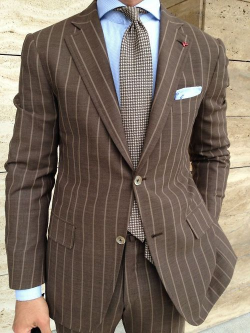 Brown pin striped suit, powder blue shirt, and brown necktie