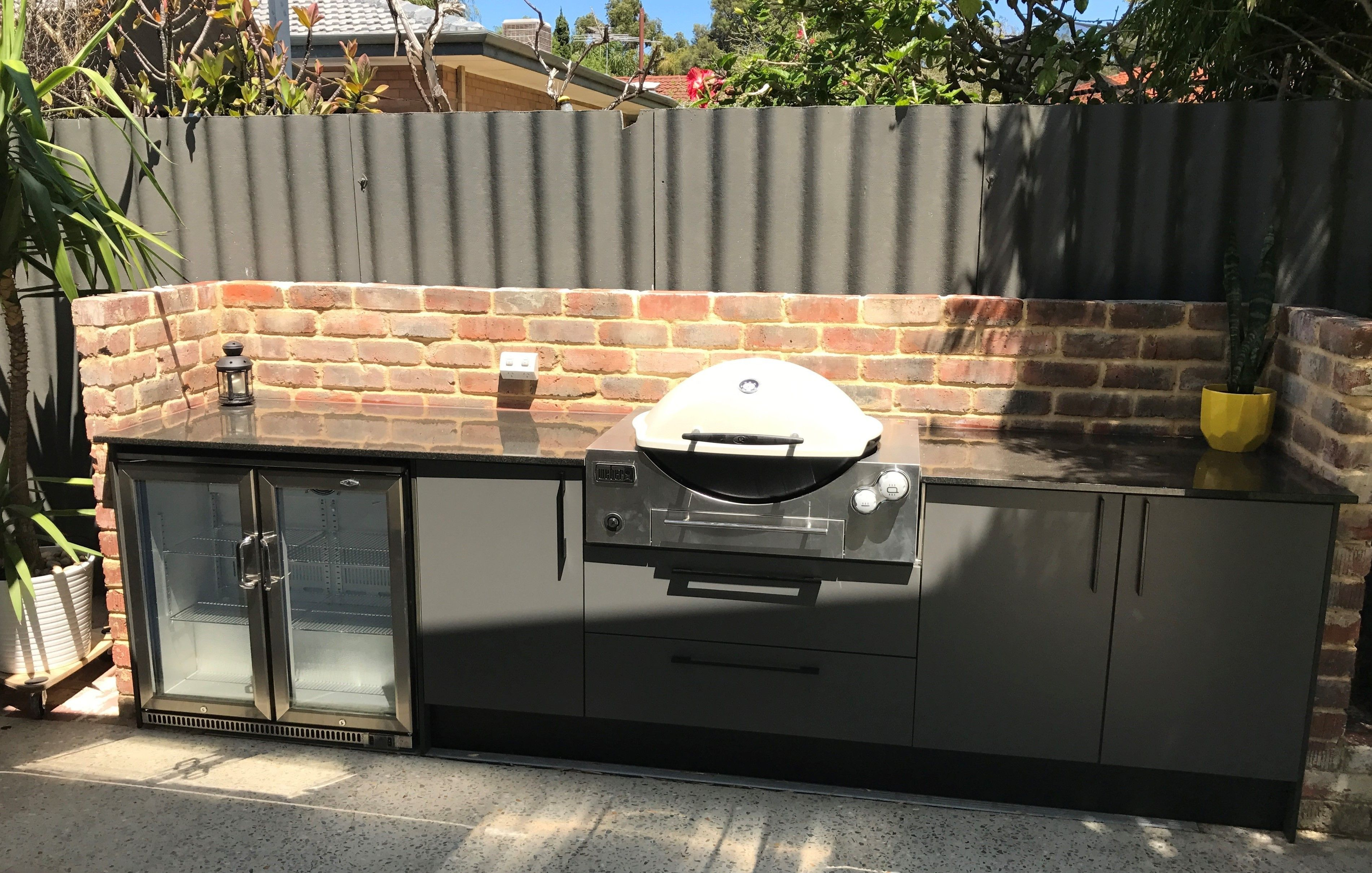 Outdoor Kitchen with Weber Q BBQ, Beefeater fridge and Laminex cabinetry