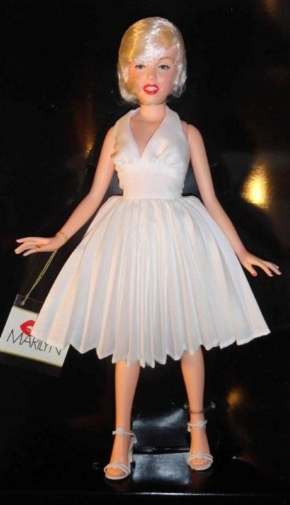 """Marilyn Monroe vinyl portrait doll wearing the white dress from """"The Seven Year Itch"""". Part of the Celebrity Series by World Doll, 1983."""