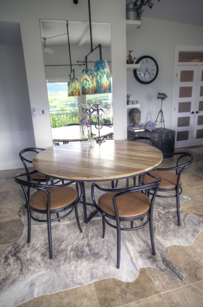 Loft Style, Round Metal And Wood Table, Cowhide Rug, Thonet Chairs. By