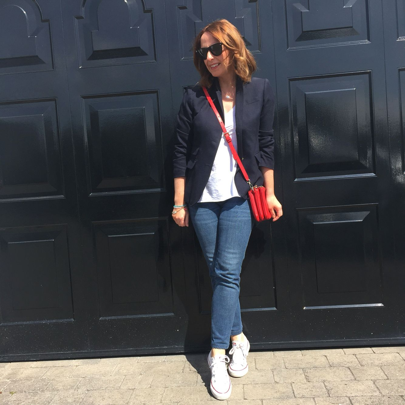 Keeping it simple in blazer jeans white tshirt converse and a red crossbody  bag 55ded68a02a48