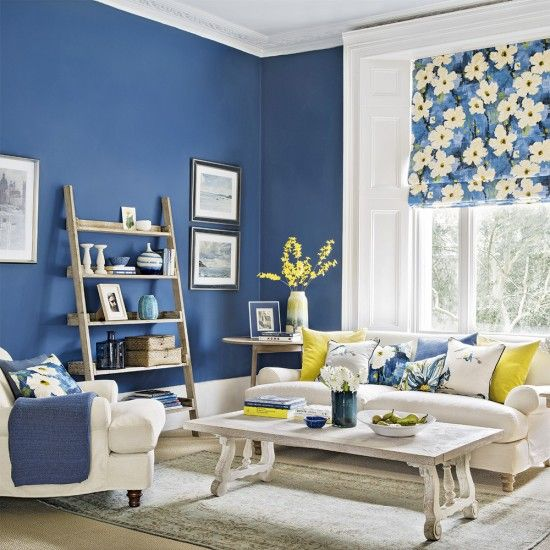 Modern blue living room with forsythia yellow accents