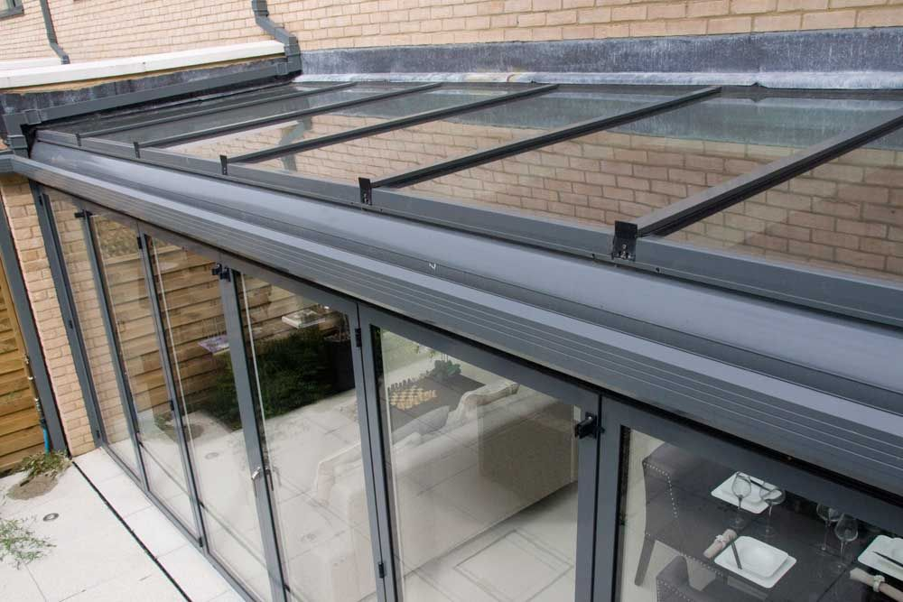 Sunflex Uk Lean To Glass Roofs With Thermally Broken Aluminium Frames Sunflex Uk Glass Roof Glass Conservatory Roof Glass Roof Panels