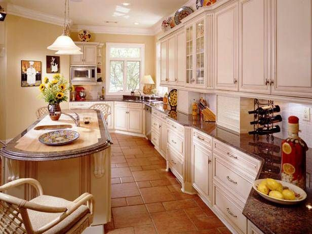 Traditional kitchen in white with ceramic tiles floor