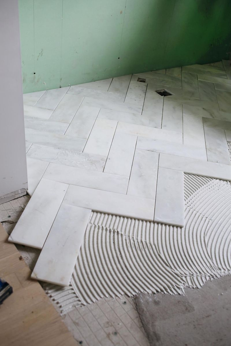 Try This Herringbone Marble Tile A Beautiful Mess Remodel Flooring Bathrooms Remodel
