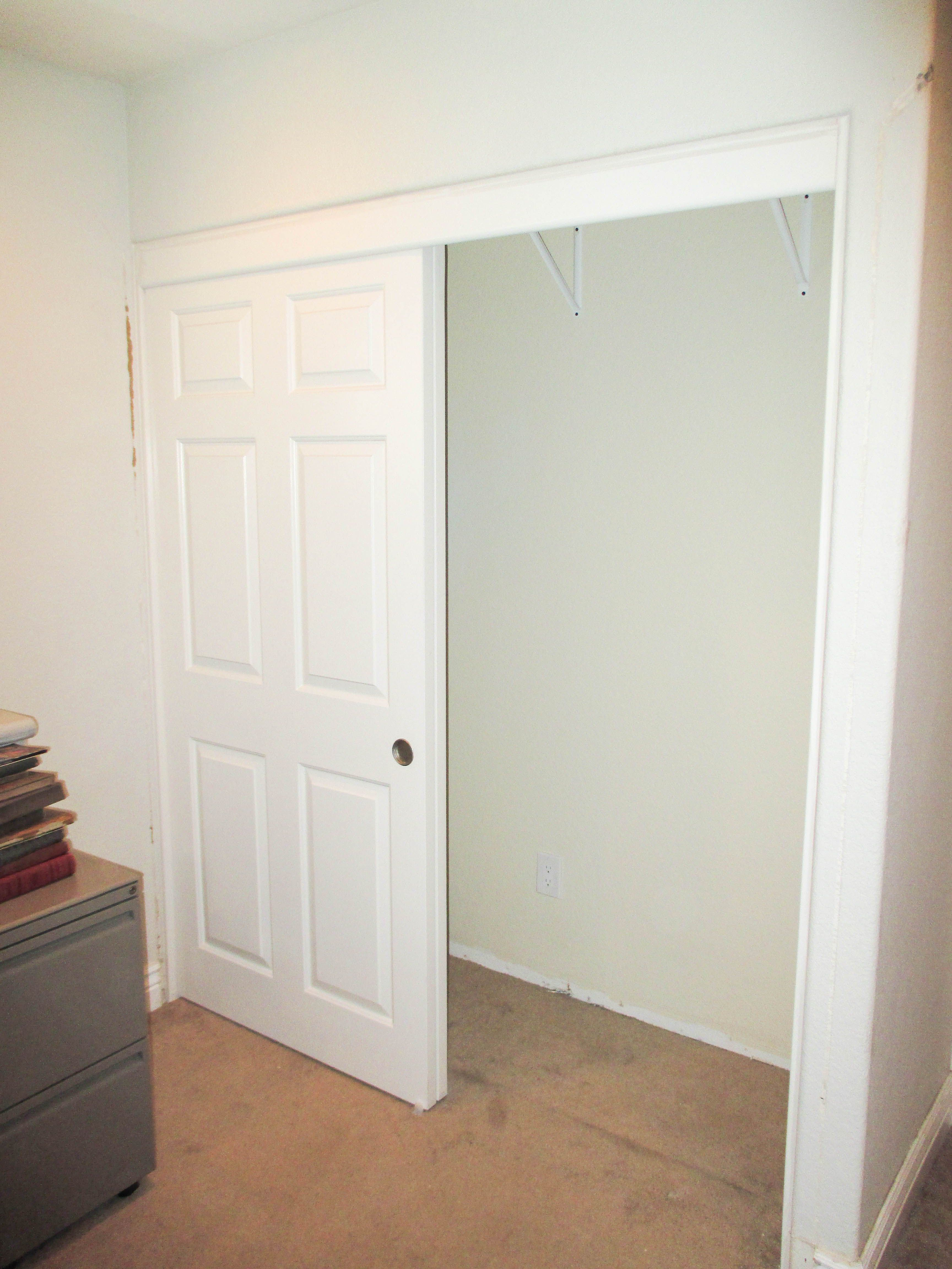 Check out these 2 track 2 panel top hung solid core Closet Doors with colonial designs that our team installed in an office If you have brand new carpet