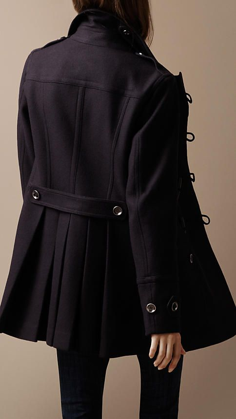 Military inspired coat with toggles and such a dark navy blue that is almost black.  Classic by Burberry