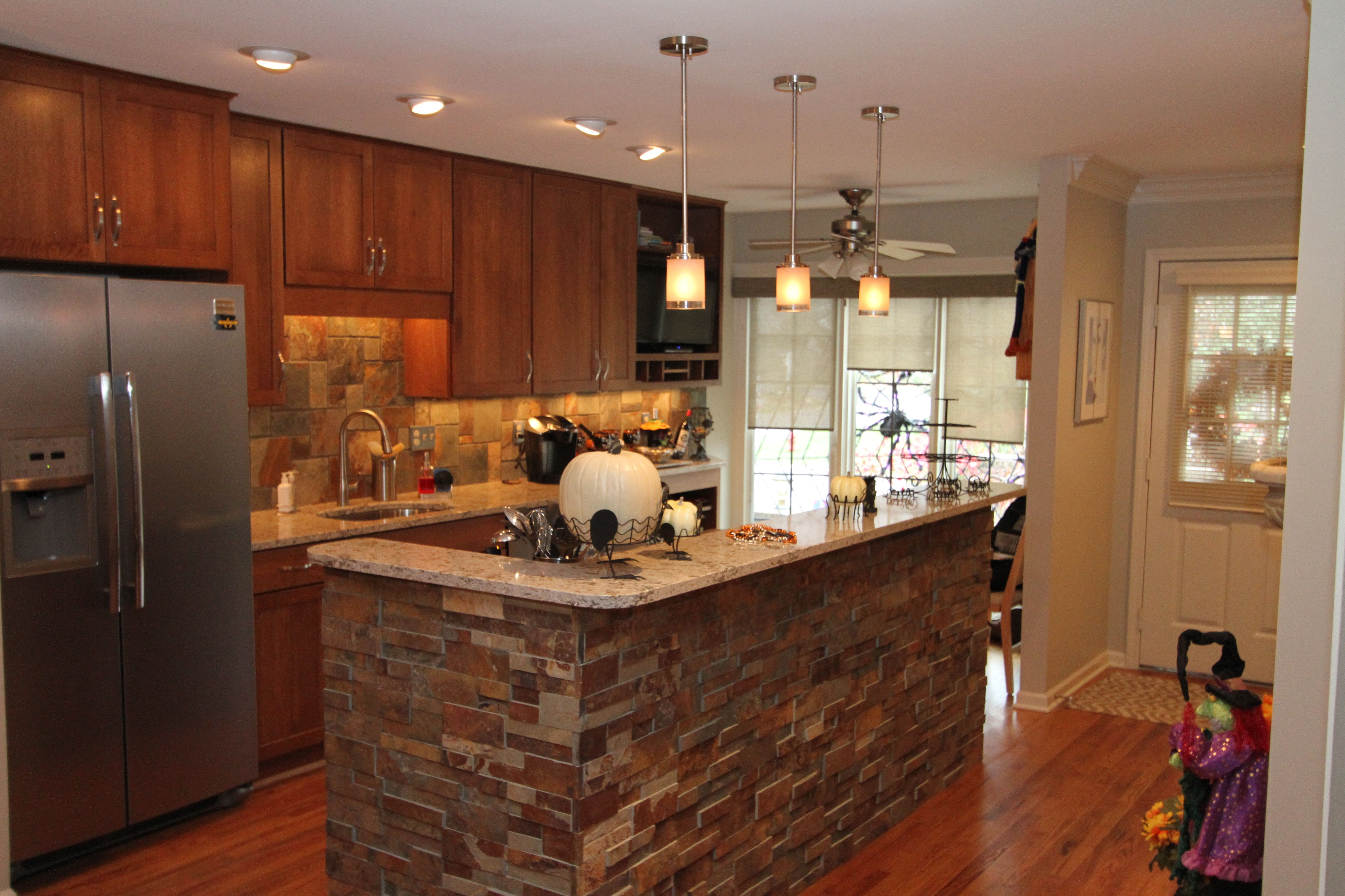 Manufactured Stone Countertops : Open kitchen with cultured stone backsplash accent wall