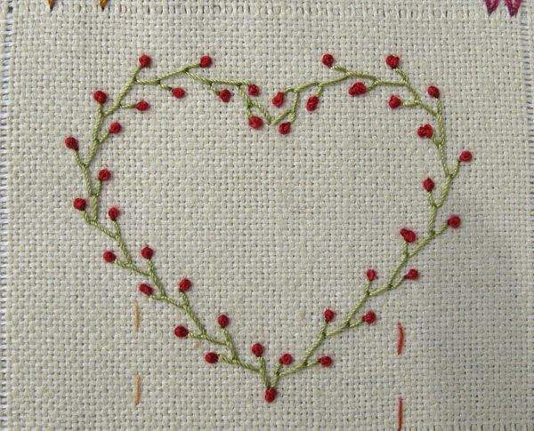Great embroidery site heart made of feather stitch and