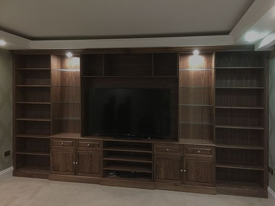 Built in American black walnut media wall unit. Bespoke made to ...