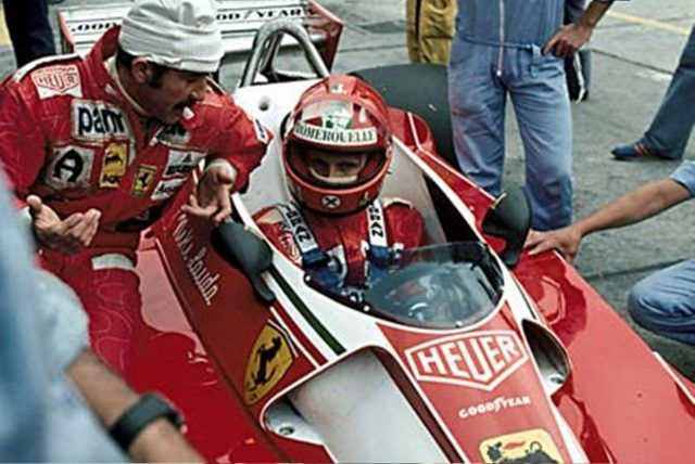 Nurburgring, August 1976: Niki Lauda chats with Ferrari team mate Clay Regazzoni ahead of the German Grand Prix which would see the Austrian crash on lap 2 with near-fatal consequences. © Schlegelmilch
