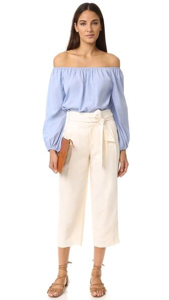 An optional sash accents the high rise of these relaxed Club Monaco cropped pants. Pleats lend movement to the silhouette. Slant hip pockets and welt back pockets. Hook-and-eye closures and zip fly.