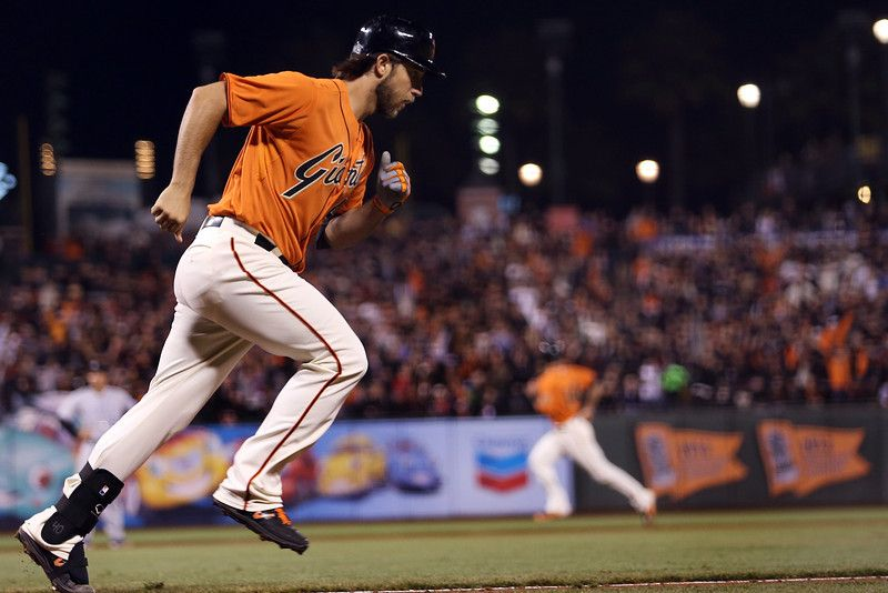 San Francisco Giants' Madison Bumgarner (40) begins to circle the bases after connecting for a grand slam off Colorado Rockies starting pitcher Jorge De La Rosa (29) in the fourth inning of their MLB game at AT&T Park in San Francisco, Calif., on Friday, April, 2014. (Ray ...