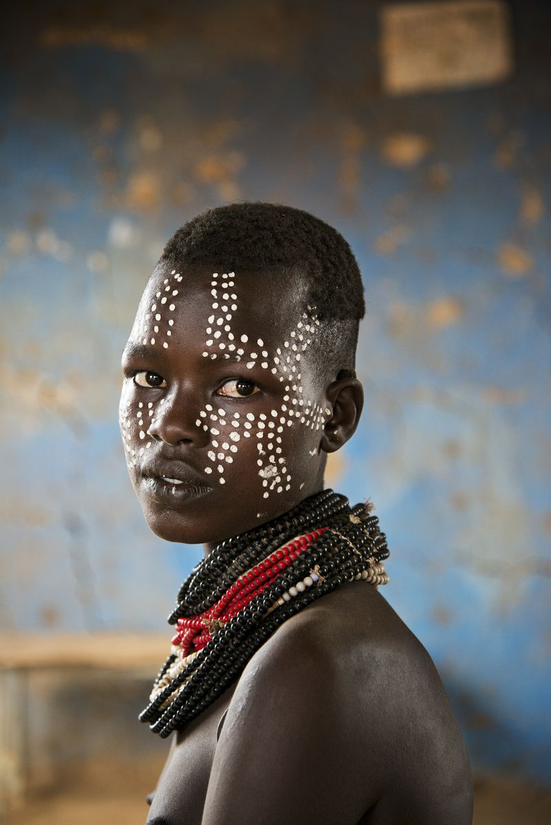 Young woman from Kara tribe in the Omo Valley, Ethiopia. By Steve McCurry. #africanbeauty