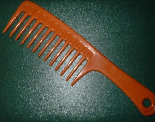 Wide tooth combs are a natural hair sistah's best friend. Don't forget whenever you comb your hair, start with the ends and work your way up.