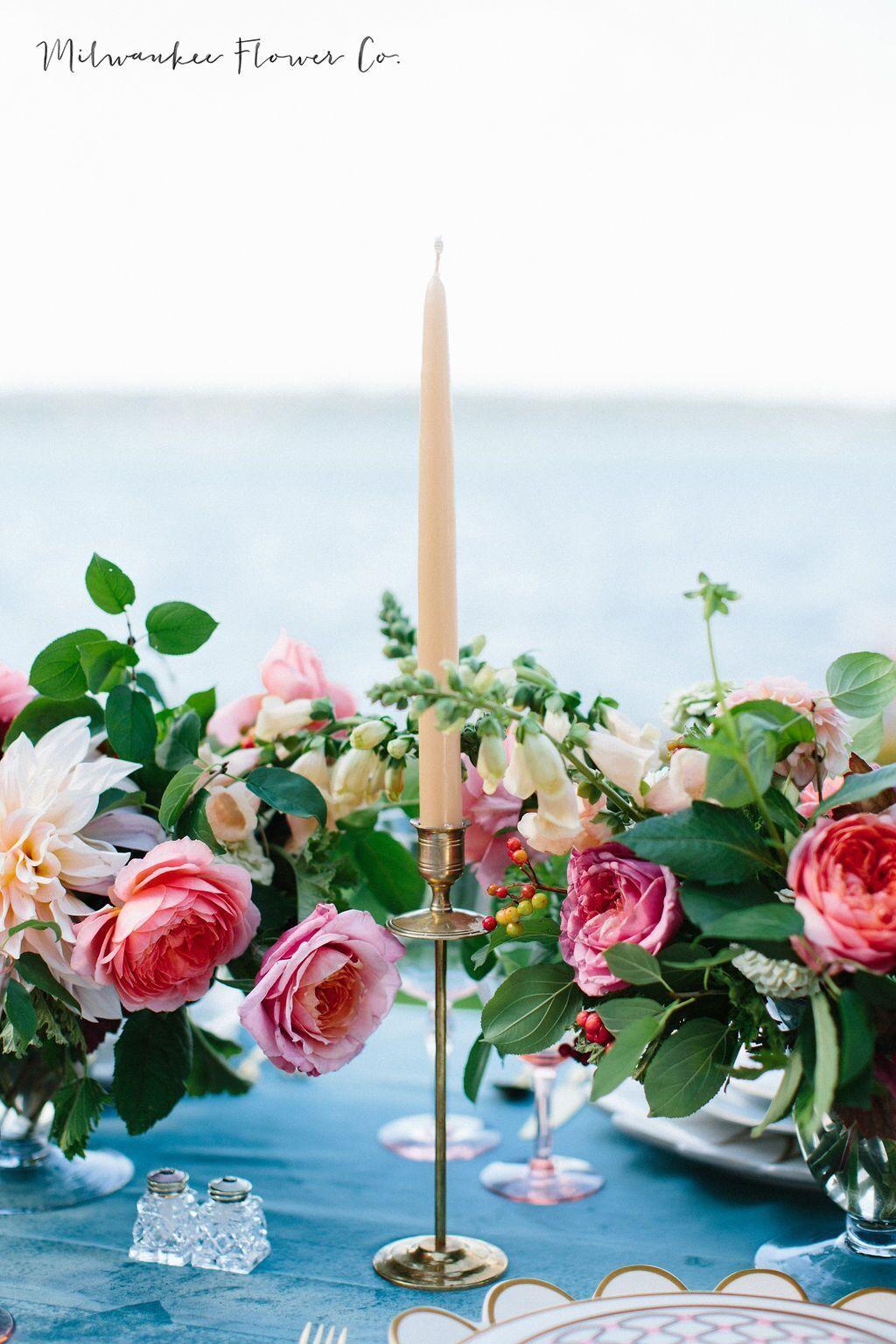 Lush centerpieces long table summer florals blush