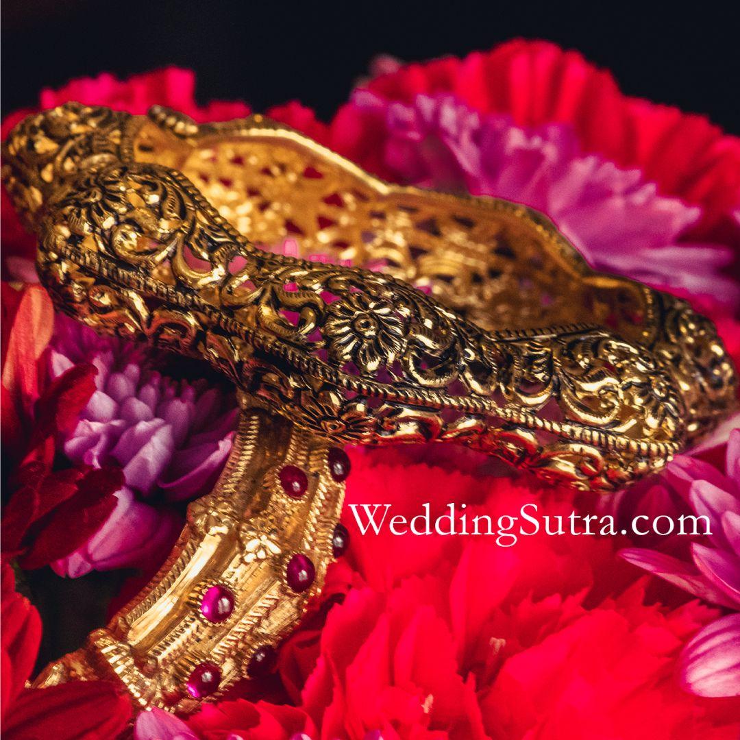 1fcd5a34569d3 Azva modern gold bangles on WeddingSutra bride #Goldjewellery ...