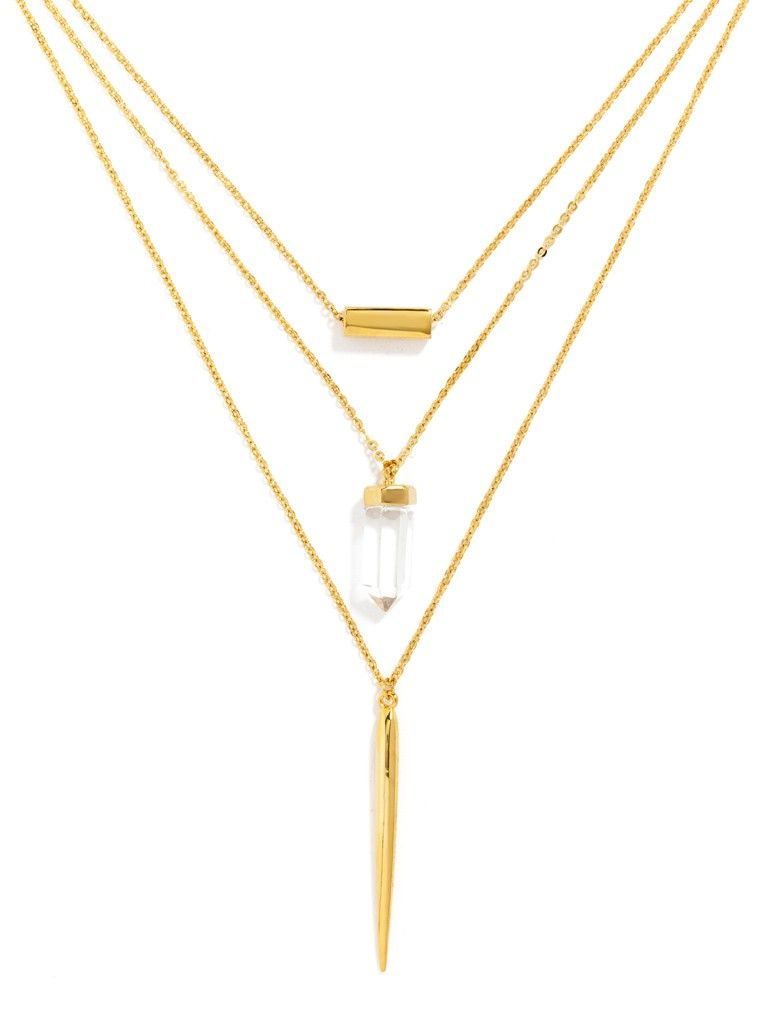 This layered necklace features a crystal charm for a chic yet graphic gold necklace that packs a multi-strand look into one piece. #baublebar #swatstyle #necklaces
