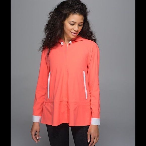 Size 8 NWT Lululemon Sun Showers Jacket Lululemon NWT Sun Showers Jacket in Size 8. Color is Grapefruit and White... Color shows most accurate on stock photo lululemon athletica Jackets & Coats