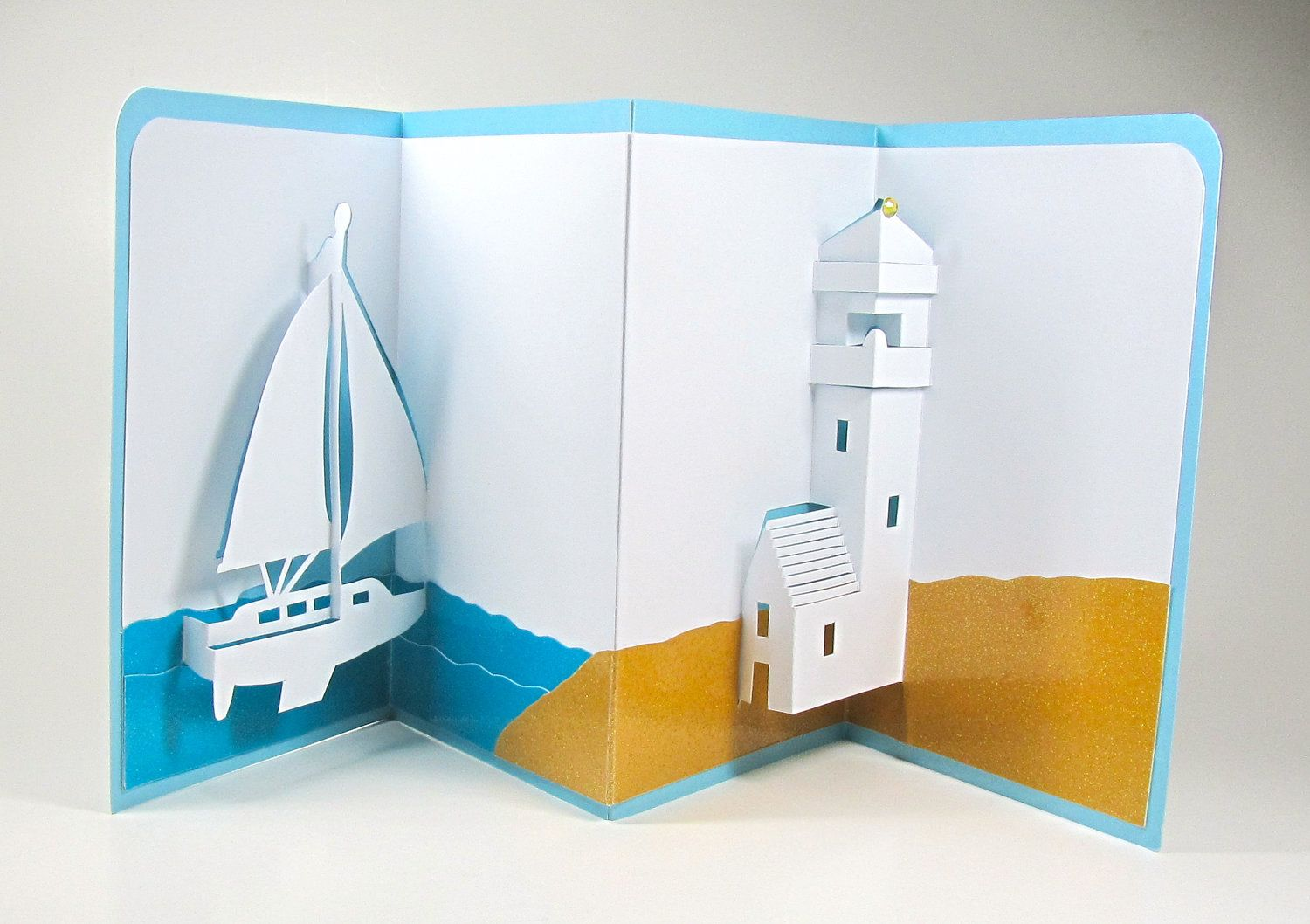 Sailboat and lighthouse nautical pop up 3d card home dcor origamic sailboat and lighthouse nautical pop up 3d card home dcor origamic architecture handmade in white kristyandbryce Choice Image